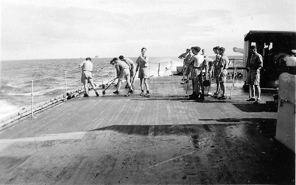 Royal Canadian Navy : Holystoning the deck on HMCS Prince Robert.