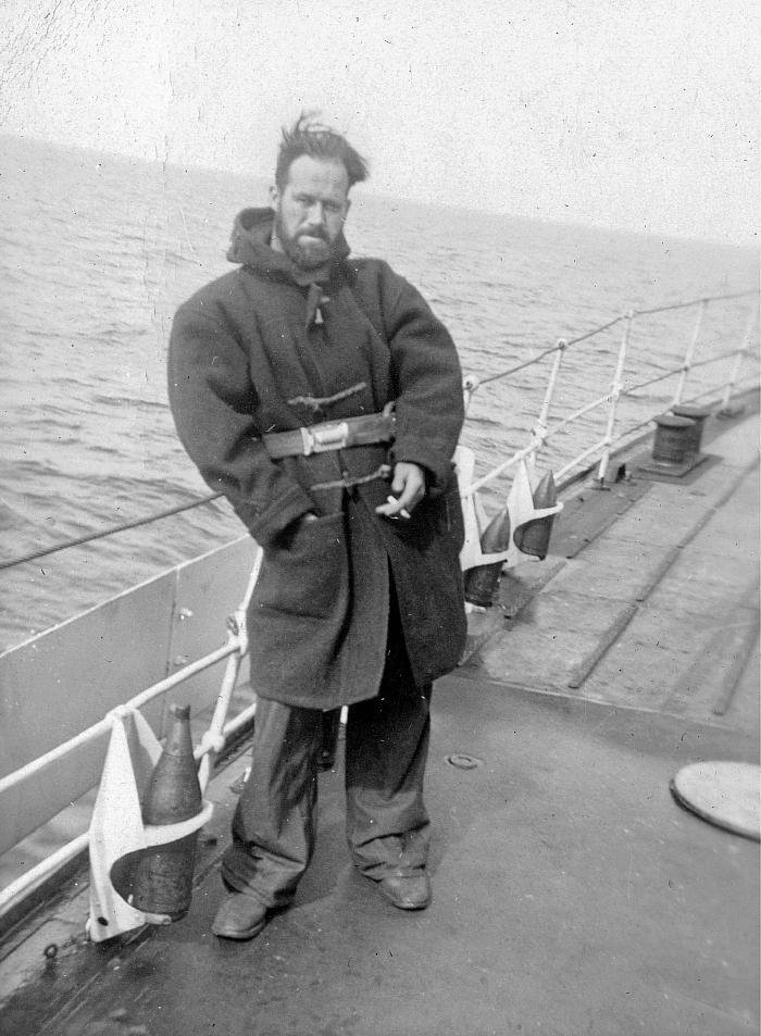 Fred Hollands in greatcoat on upper deck of HMCS Skeena